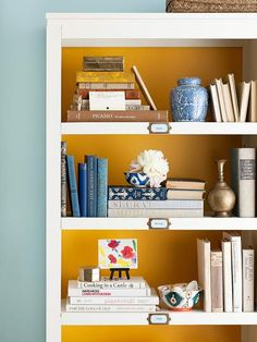 Love this bookshelf styling with blue accents | via BHG.com