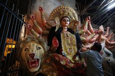 An artist gives final touches to an idol of the Hindu goddess Durga in Allahabad.