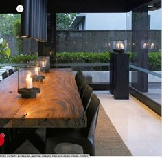 Floor to ceiling glazing and the natural wood furniture