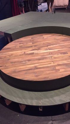 Painted wood grain and took four feet of luan to cover the six foot of circular stage.