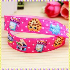 FOE Fold Over Elastic - Shopkins Print - Pink Size - 5/8 Inch - 16mm  Length - 1 metre lots - You choose how many metres that you would like to purchase  Multiple purchases will be cut as a continuous order for you.  Perfect for making decorative headbands, interchangeable headbands, baby, toddler child and adult headbands, hair ties, barefoot sandals, scrap booking, card making, decorating dresses, bibs, nappy covers and general sewing as well as gift wrapping and many more ideas.  Plea...