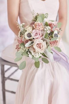 """This order is for one Bridal Bouquet. Option #1 & 2: Antique Pink & Lavender (Seasonal) / With Chiffon Ribbon Recipe: Garden Roses, Anemones*, Roses, Carnations, Spray Roses, Eucalyptus, Dusty Miller, Limonium, Statice Size: Bouquet measures approximately 11"""" tall with a diameter of 8-10"""" Accessories: P"""
