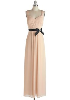 This long flowy dress is already perfect for a formal dinner party, but throw in the sparkle on the black bow and sides and it's immediately kicked up a notch! The black of the bow stands out from the nude colored dress, similar to how you would stand out from the party's crowd! I love this stunner!