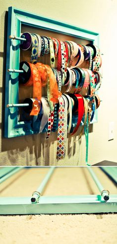 HOOKS & RACKS :: DIY Ribbon Rack Tutorial :: Couldn't be easier...a frame, some dowels, hooks & picture hooks to hang it with. Cheap & easy. Love that. | #racks