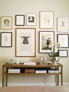 Wood and black frames on a simple gallery wall for containing prints & photos to one small space