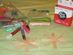 POPSICLE SNOWFLAKES & more Winter Crafts for Kids (wooden popsicle sticks + glue dots + glitter pens + ribbon = fun to hang in the windows)
