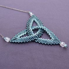 Peyote celtic knot. Tutorials can be found in book shaped beadwork of Diane Fitzgerald.