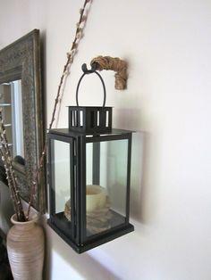 Repurposing Old Curtain Rod bracket to hold lanterns on wall