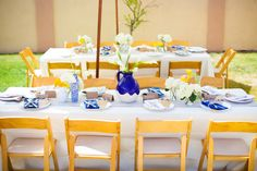 Loving these mix and max vases in bright blue and white! - Summer Backyard Baby Shower with a Nautical Theme captured by Epper Photographer