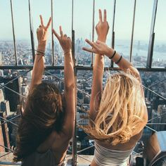 Two guests enjoy the expansive views from the Empire State Building's 86th floor Observatory. Photo by Noel A.