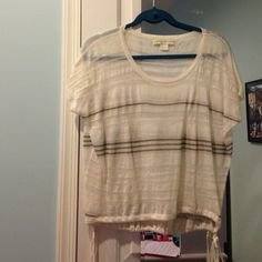 White short sleeve top with sparkly gold stripes Short sleeve, flowy white shirt with sparkly gold stripes and ties on each side. In great condition! Staring at Stars Tops