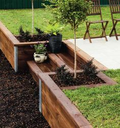 Front Yard Landscaping Landscape with steps: Customise a timber retaining wall on a sloping site for stepped access that doubles as seating in a terraced garden.