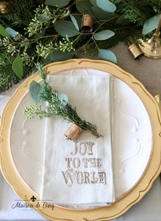 place setting with white plates gold chargers and brass bells with greenery French Country Christmas, Elegant Christmas, Cozy Christmas, Perfect Christmas Gifts, Simple Christmas, White Christmas, Christmas Ideas, Christmas Table Settings, Christmas Tablescapes