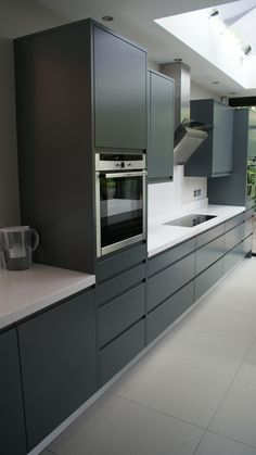 Modern handle-less grey matt painted bespoke kitchen with white Silestone tops in Kingston Surrey. Designed & fitted by . Bespoke Kitchens, Grey Kitchens, Cool Kitchens, European Kitchens, Modern Kitchens, Grey Flooring, Kitchen Flooring, Kitchen Cabinets, Grey Cabinets