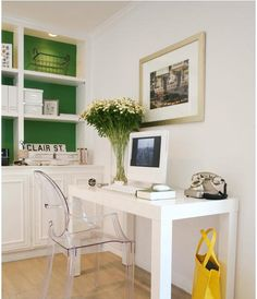Splash of color on back wall of bookshelves + parsons desk + ghost chair