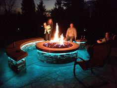 Awesome outdoor fire pit finally completed with lava rock and natural gas!!!