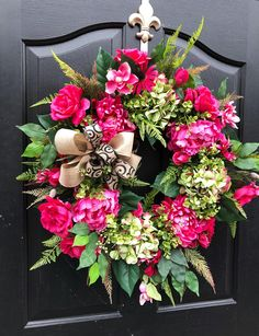 NEW item! This one of a kind wreath is Ready to Ship and is perfect for spring and summer! Made up an 18 grapevine wreath with ficus, ferns, hydrangea leaves, and more! Gorgeous fuchsia peonies, zinnias, pink daisies, roses, mixed green/pink hydrangeas and cherry blossoms make up this