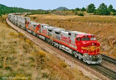 ATSF #691 (GE C44-9W) leads a double stack @ Williams AZ. 09-29-1994. Photo by James Belmont.