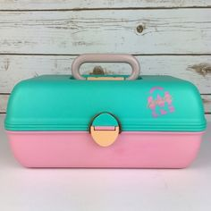 """[Vintage] Caboodles Cosmetic Case Large 80s Retro If you were a child of the 80s/90s there was a good chance you had one of these! Mine was filled with Lip Smackers, Wet N Wild, jewelry, teen mags, and more. A retro colored treasure chest. This can be used to store so many things and is a great travel convo piece! Caboodles of California.  Dimensions: 12""""L x 6""""H x 6.5""""D Large size and inner compartments Condition: GUC. Some light surface scratches. Main signs of wear is on bottom as shown in…"""