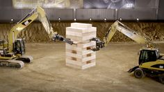 """Caterpillar Plays Jenga With 600-Pound Blocks And Massive Machines Soundtrack: """"In the Hall of the Mountain King"""" from Peer Gynt by Edvard Grieg"""