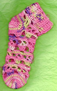 Creepy Skulls Socks by Spider Mambo - This pattern is available for $1.00 USD. Skull patterned open work . The socks are made toe up with optional afterthought heel. Designed so that you can replace just the heel if you get a hole. There are directions for any length sock up to the knee. Use either sock yarn or heavier sport and dk weights. there are pictures of almost every step. Size is determined by the size of the needle you are using. Go up a size or down a size to achieve the perfect…