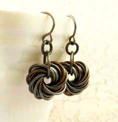These hand crafted earrings feature endless spirals of gunmetal and just a hint of vintage bronze...or gold or purple or over 30 other colors! They are a dramatic and dressy interpretation of a classic chainmaille pattern! They cascade and shimmer just under 1 1/2 inches( 3cm) and can be switched to clip ons or post tops.