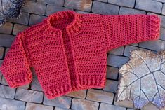 Infant Bomber Cardi Crochet Pattern month) - Crochet - If you have a little lady that needs a cute little cardigan, this free pattern is for you! Whip up - Crochet Baby Sweater Pattern, Crochet Baby Sweaters, Baby Sweater Patterns, Crochet Coat, Crochet Baby Clothes, Crochet Patterns, Booties Crochet, Baby Bomber Jacket, Patterned Bomber Jacket