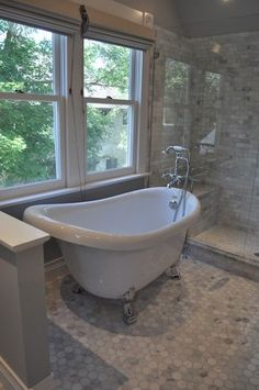 Blank and Baker: Beautiful master bathroom with clawfoot tub and vintage style floor-mount tub filler ...