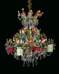 """Pepon Osorio - """"El Chandelier"""" functional metal and glass chandelier with plastic toys and figurines, glass crystals, and other objects"""