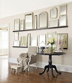 How to Decorate with Mirrors:  Two rows of shelves and lean a bunch of mirrors on them.
