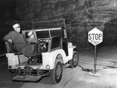 in the Salt Mines under Michigan. There were 50 miles of road in the salt mines under the city of Detroit, Michigan. Circa: August Traffic controls in the salt mine in August The Detroit News archives. Detroit News, Detroit Michigan, Salt Mining, Jeep Cj, Jeep Willys, Vintage Jeep, Classic Image, Great Lakes, Geology
