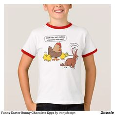 """Funny Easter Bunny Chocolate Eggs T-Shirt A Hen and her Chicks """"Look kids, he's making chocolate mini-eggs."""" The chicken says as they watch the bunny rabbit. The bunny silently giggles """"hehehe"""" because he knows he's pooping. Funny Easter cartoon / comic."""