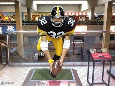 Statue of Franco Harris making the Immaculate Reception -- Pittsburgh International Airport