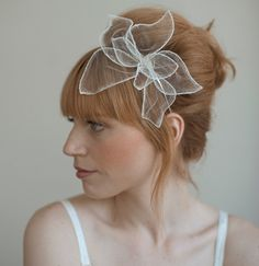 Subtle but distinctive hair accessory for wedding. Wonder if this would get gobbled up by big, soft curls...