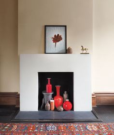 show off a collection of vases in non-working fireplace