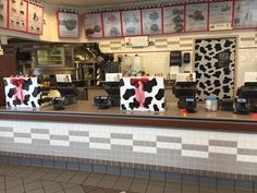 CAD: Cow print tablecloths wrapped around POS, mini cows above the menus, cow print tablecloth covering the kitchen door. Cow Appreciation Day, Employee Appreciation, East Ridge, Mini Cows, Balloon Arch, Cow Print, Tablecloths, Pos, Arches