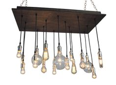Rustic Chandelier with vintage style bulbs. This rustic Industrial style chandelier has a solid wood base and includes a 2 recessed matching