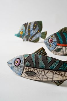 Julian Smith----3 little Raku fishes, swimming in the sea...