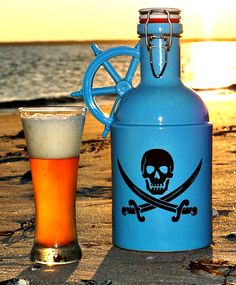 """""""The Jolly Roger"""" 64oz Craft Beer Growler.  Premium stoneware slip-cast by hand in the USA. A perfect gift for the beer lover in your life... Get it at: http://goosecreekgrowlers.com/products/the-jolly-roger-blue-64-oz-custom-graphic"""