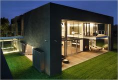This ultra-modern house by KWK Promes may look like just another minimal piece of architecture, but the unsuspecting luxury home can transform into an Amazing Architecture, Interior Architecture, Installation Architecture, Zombie Proof House, Casa Bunker, Bunker House, Future House, My House, Houses In Poland