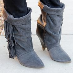 """Isabel Marant fringe leather & suede boots size 38 Cute fringe boots by Isabel Marant for H&M. Size 38 (U.S. size 7). Worn twice. Some signs of light wear on heels and soles and fading on top of leather. Slouchy, fringe slip-on style.  Can be worn folded over or pulled up. Pointy toe shape. Leather and suede construction features dark grey suede and black leather. Cone shape heel. Height of heel is 3.5"""". Leather soles. ❌No trade. ❌No PayPal. ❌No low offers. Isabel Marant pour H&M Shoes…"""