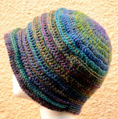 Another version of Sarah's Flapper hat - I love it, so easy to wear and folds up small. This is in a soft mohair mix with beautiful colour changes.
