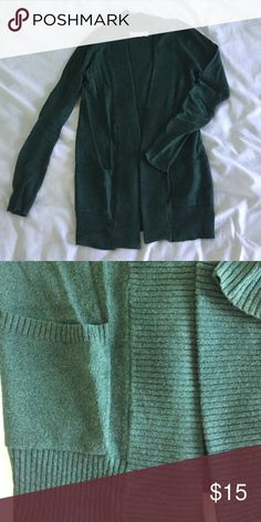Urban Outfitters dark green cardigan Urban outfitters dark green cardigan.  2 pockets in front. Long sleeves. MAKE AN OFFER, WILLING TO NEGOTIATE. Urban Outfitters Sweaters Cardigans
