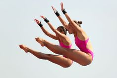 Zsofia Reisinger and Gyongyver Villo Kormos of Hungary compete in the Women's 10m Platform Synchronised Diving preliminary round on day three of the 15th FINA World Championships at Piscina Municipal de Montjuic on July 22, 2013 in Barcelona, Spain.