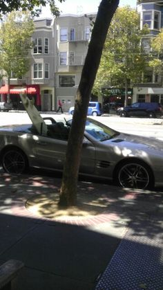 Surf board sticking out of Mercedes is very San Francisco!