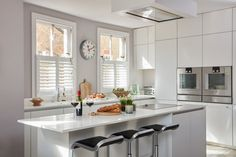 Kitchen & Dining Room Shutters by Plantation Shutters Ltd White Shutters, Interior Window Shutters, Diy Shutters, Cafe Style Shutters, Kitchen Shutters, Patio Door Blinds, Patio Doors, Traditional Shutters, Richmond Homes