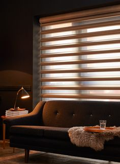 Pirouette® Shades from Luxaflex®. Soft fabric vanes give a clear view to the outside whilst maintaining privacy inside.