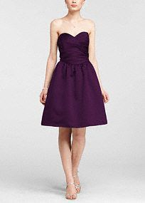 Classic silhouette with modern dayupdates, this dressis a sweet look your bridesmaids will love!  Strapless ruched bodicewithultra-feminine sweetheart neckline.  Pleated waist flows into full skirt with crinoline and features trendy side pockets.  Fully lined. Imported polyester. Back zip. Dry clean only.