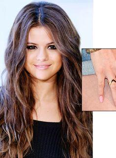Selena- like her nail color.