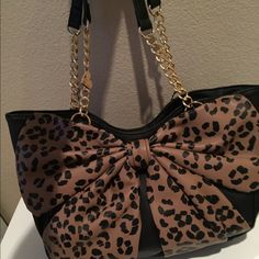 Lowest Until Midnight  Betsy Johnson bow purse Stunning purse! Big leopard bow on the front. Has 2 magnetic clips and zipper in the middle for closure. NWT Betsey Johnson Bags Shoulder Bags